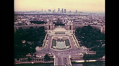 Paris Eiffel Tower aerial view panorama of Paris with Senna river and bridges, Palais de Chaillot palace in the 70s. Jardins du Trocadero gardens. Historic archival footage from 1976 in France.