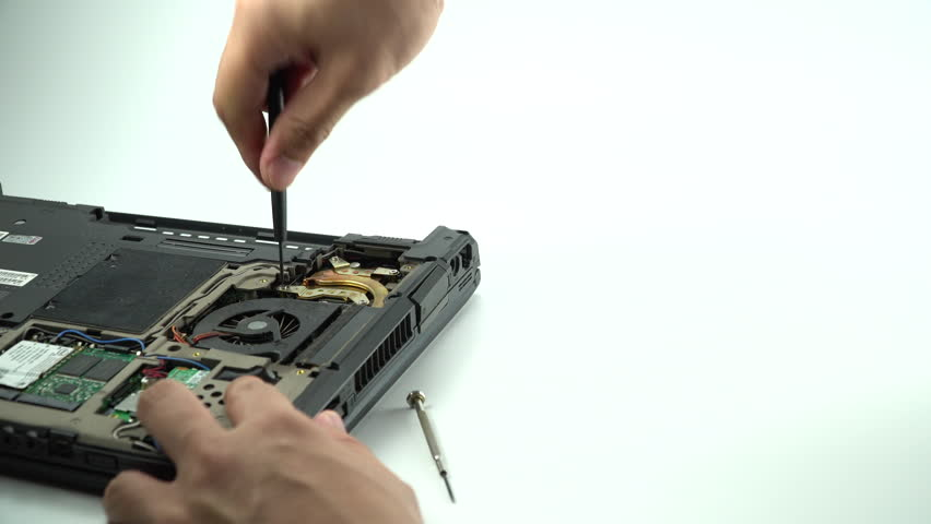 Computer repair concept.Close up the man repair Laptop motherboard with screwdriver. Maintenance cpu hardware upgrade of motherboard.Hard disk drive,PC repair electronic engineer of technology.