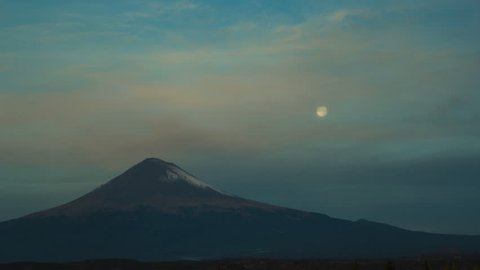 incredible time lapse of the popocatepetl volcano and full moon at sunrise