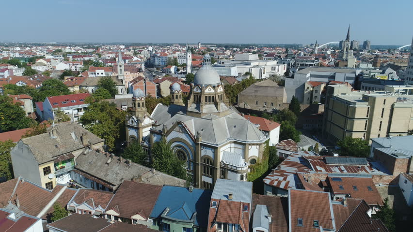 NOVI SAD, SERBIA - OCTOBER 2017: Aerial view flying over Jewish synagogue towards Catholic and Orthodox church in Novi Sad, Serbia