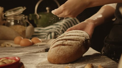 Baker puts bread on table