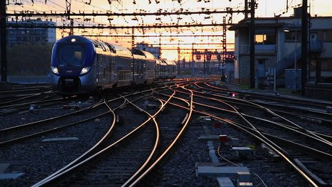 PERRACHE STATION, LYON, FRANCE -  October 26,  2017: Train entering train station Gare de Lyon-Perrache at dawn. Lyon, France.