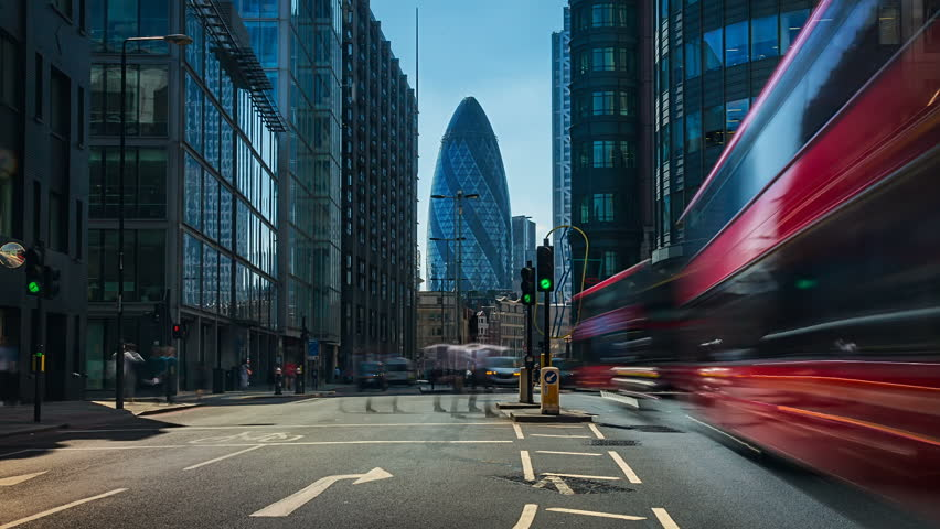 London, England. Circa, 2016. Hyperlapsed view of the iconic 30 St Mary Axe also known as The Gherkin, from Norton Folgate St. in London financial district. Zoom in.