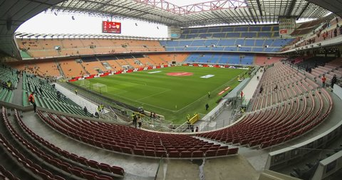 San Siro Stadium Timelapse inside,  football arena in Milan, Italy. Seats filling up with crowd of soccer fans during a match - Milan 19-03-2018