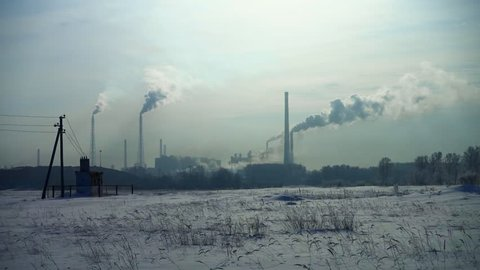 Air pollution from industrial plants. Frosty in the winter ecology mud greenhouse effect.
