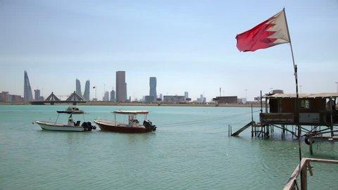 Bahrain. Fishermen House and Boats. Flag and Manama Skyline