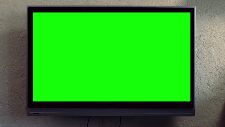 Flat screen TV with green screen composited. TV or television - green screen - room - on the wall. LCD TV with track green screen in modern livingroom #1008811871