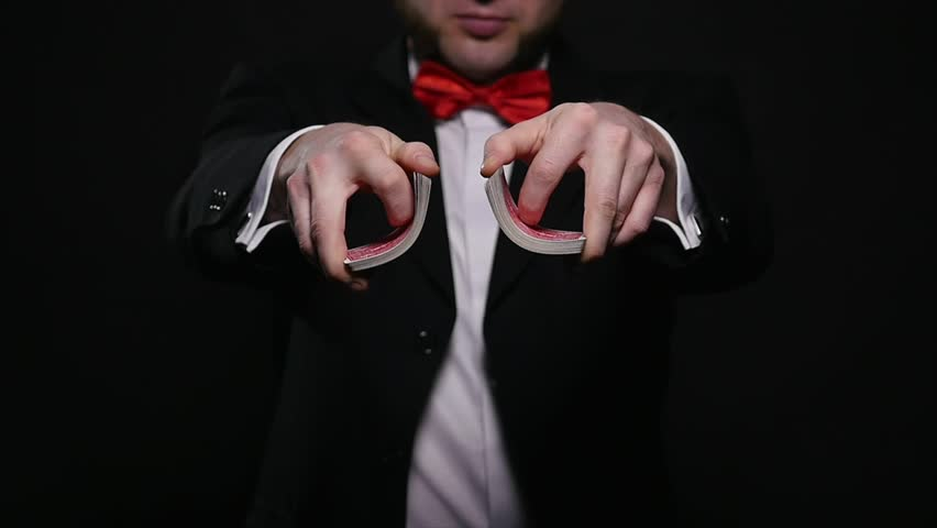 Magic, card tricks, gambling, casino, poker concept - man showing trick with playing cards | Shutterstock HD Video #1008822371