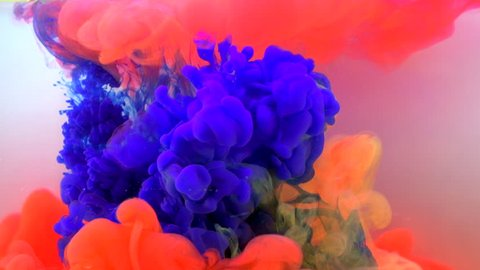 Real shot color paint drops in water in slow motion. Ink swirling underwater. Cloud of ink collision. Colorful abstract smoke explosion animation. Close up view