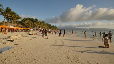 Boracay, Philippines - January 5, 2018: Vacationers on the sunny beach of the island of Boracay. Philippine exotic tropics. Shooting in motion.