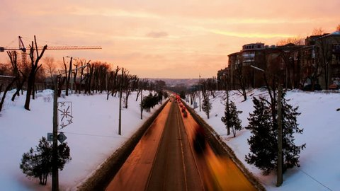 Kharkiv, Ukraine. Klochkovsky descent during the night in Kharkiv, Ukraine. Time-lapse of car traffic light at sunset with city at the background. Illuminated snow in winter