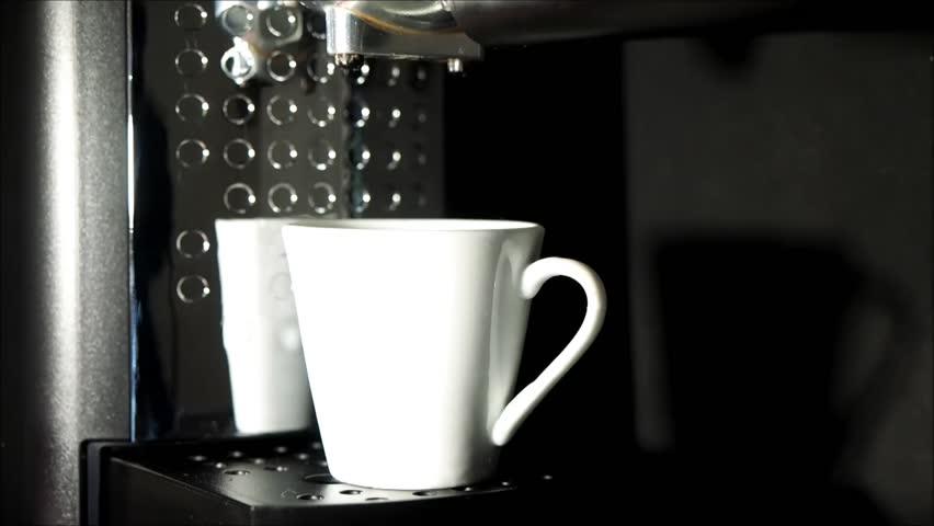 Making coffee in the coffee machine. Close up   Shutterstock HD Video #1008887681