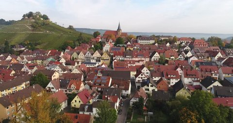 Flying copter over the beautiful rural town Weinsberg near the Burgruine Weibertreu in Heilbronn, Germany. 4k footage.