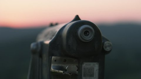 Monocular at a mountain overlook