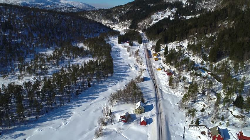 AERIAL. Train Oslo - Bergen in mountains. Hordaland, Norway.