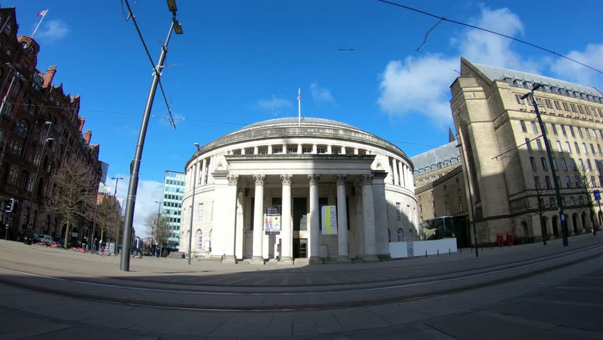 MANCHESTER, ENGLAND - MARCH 17:  A time lapse recording of pedestrians and trams passing Manchester Central Library in Northern England on March 17, 2018.
