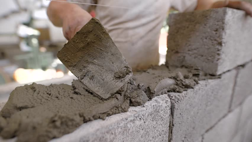 Close up of a bricklayer on a construction site with a trowel | Shutterstock HD Video #1008958091