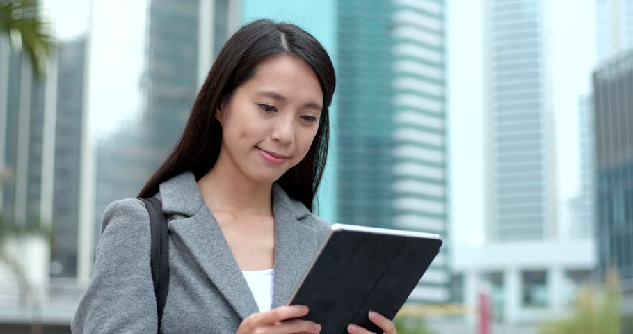 Business woman use of tablet computer in city | Shutterstock HD Video #1008962981