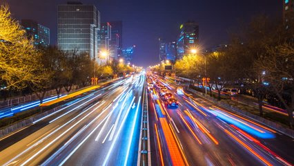 timelapse of busy traffic and modern building in beijing china