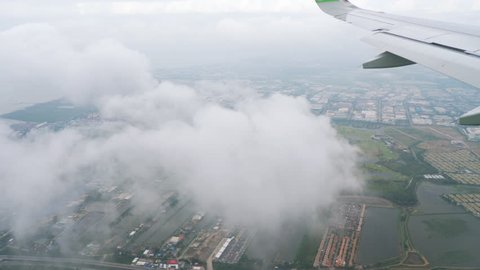 BANGKOK, THAILAND - NOVEMBER 11, 2017: Airplane Airbus A320 NEO approaching during the rain at Suvarnabhumi airport, Bangkok, Thailand
