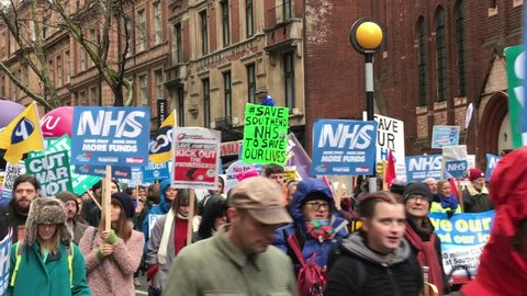 London, United Kingdom (UK) - 02 03 2018: Large group of protesters against NHS budget cuts walking in central London