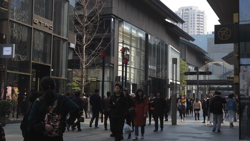Chengdu Mar 1,2018: slow motion of people walking in the Taikoo Li in Chengdu Sichuan China.