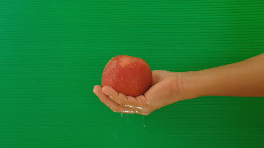 Washing off an apple with slow motion on green background, | Shutterstock HD Video #1009102211
