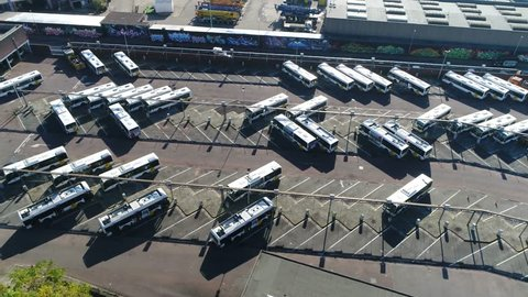 Aerial bird view of bus terminus is designated place where bus or coach starts or ends its scheduled route termini can be located at stations interchanges garages or bus stops 4k high resolution