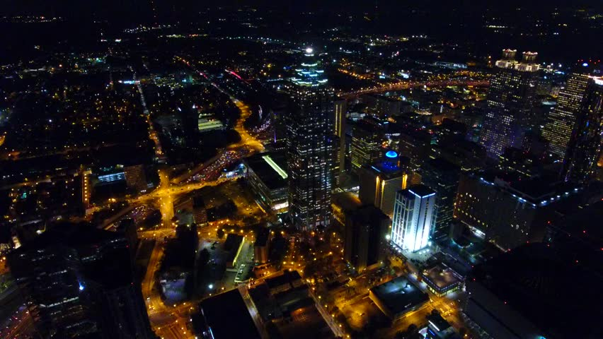 Night cityscape of atlanta, aerial bird's eye drone flying over downtown. camera moving forward. Georgia USA. real time