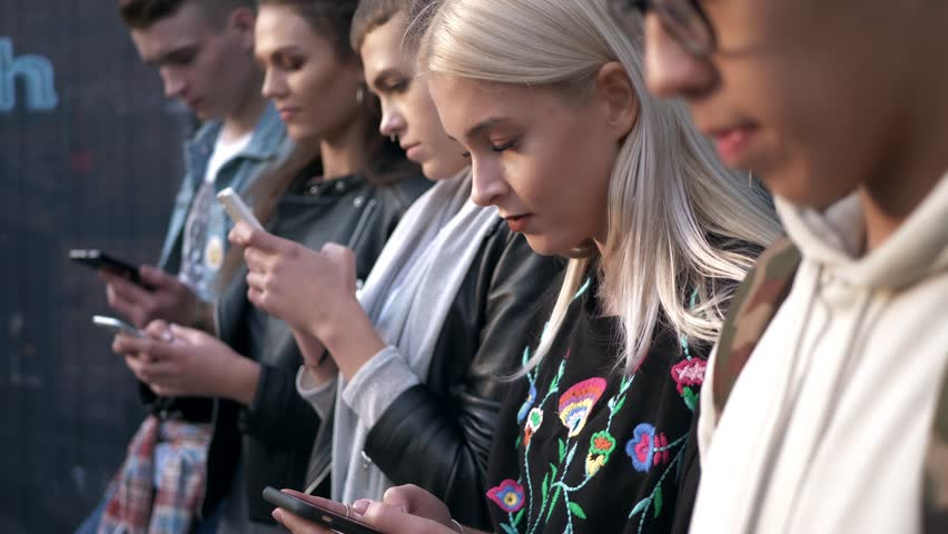 Defocused group of student using  mobile phone  | Shutterstock HD Video #1009141991