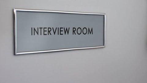 Interview room door, hand knocking, business recruitment, hiring candidate
