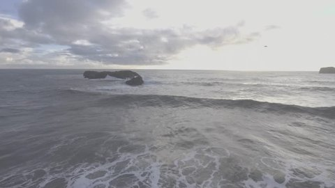 Watch as the waves flow in from Iceland's southern coast during the golden hour.