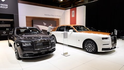 BRUSSELS, BELGIUM - JANUARY 10, 2018: Rolls Royce Phantom (Rolls-Royce Phantom VIII) and Rolls-Royce Wraith luxury exclusive cars on display at the 2018 European motor show in Brussels.