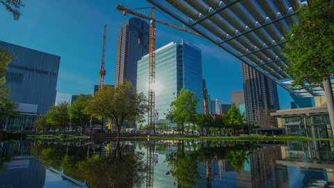 Dallas Arts district construction cranes reflecting in water- time-lapse