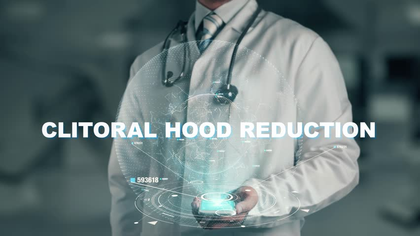 Doctor holding in hand Clitoral hood reduction