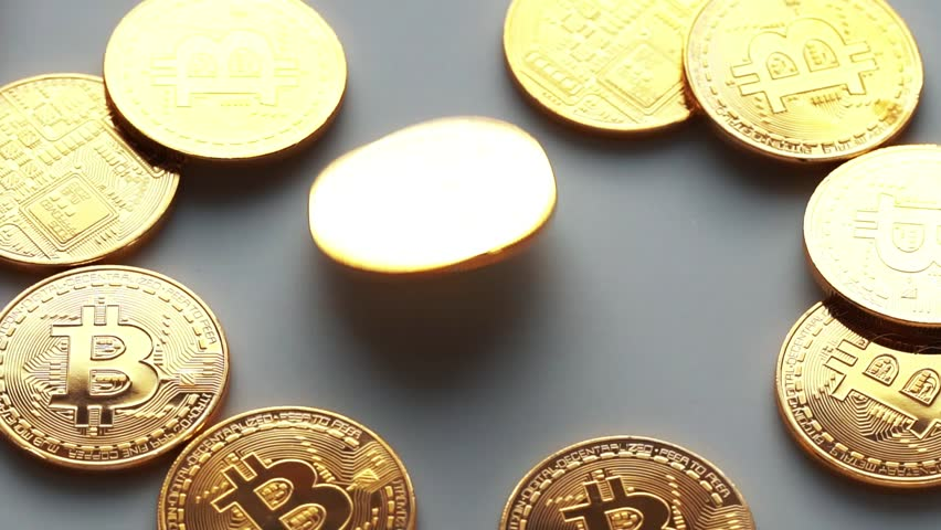 Coin golden bitcoin rotation, twist and falls on a white background. Slow motion video 120 fps. | Shutterstock HD Video #1009266641