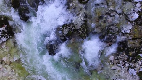 AERIAL top down view: flight over mountain river