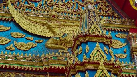 Steadycam shot of a buddhist temple Wat Putta Mongkon, Wat Mongkol Nimit, in Phuket town, Phuket island, Thailand