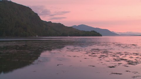 pan to see Eilean Donan Castle at sunset, Kintail National Scenic Area, Dornie, western Highlands,  Scotland