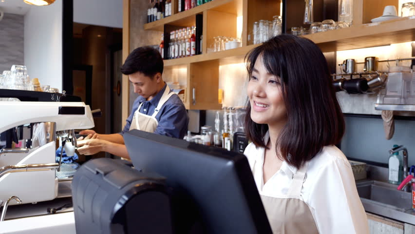 Asian people working at cafe. People working concept. | Shutterstock HD Video #1009341251