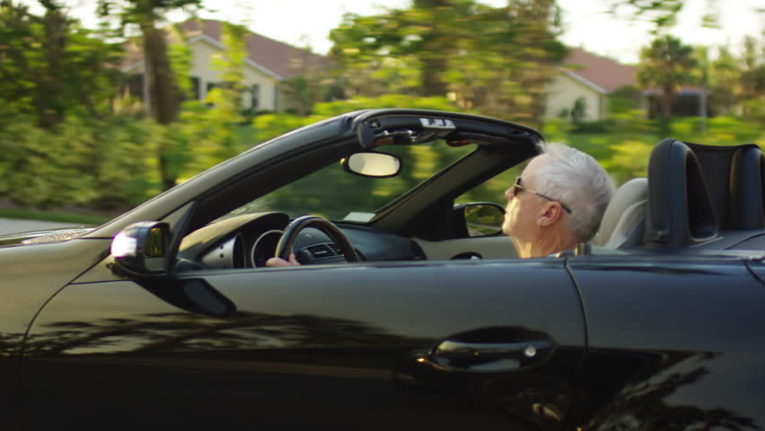 Side View Of Active Senior Driving His Luxury Convertible Around Sunny Florida - Shot On Red Scarlet-W Dragon In 4K/ Slow Motion