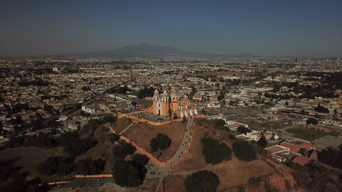 An aerial drone approach of the Great Pyramid of Cholula in Puebla Mexico.