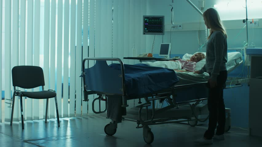 Sick Little Child Lying in the Hospital Bed Sleeping, Her Mother Worries Sits on a Chair Beside, Hoping fore the Best. Dramatic Family Moment. Shot on RED EPIC-W 8K Helium Cinema Camera. | Shutterstock HD Video #1009393571