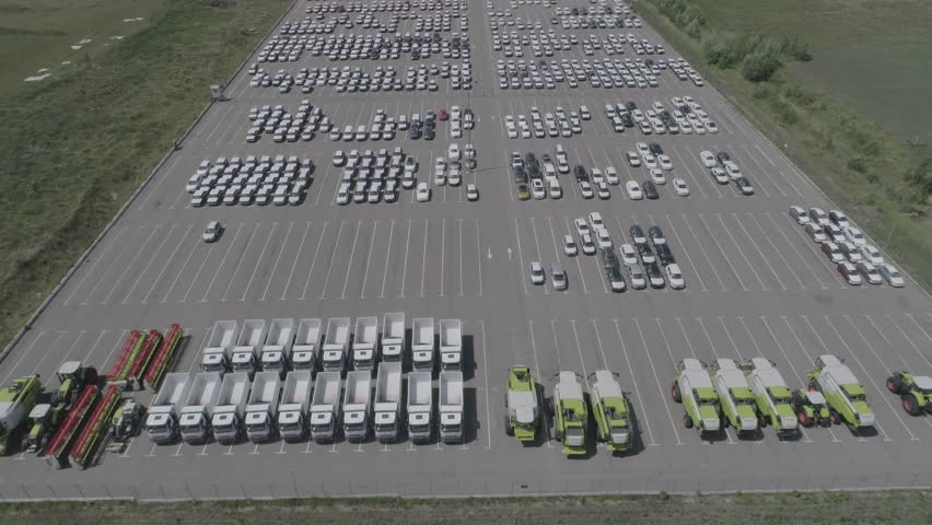 Aerial view of new car storage parking lot. Car park view from above. Pattern of parked cars in an open car park. Video 4k | Shutterstock HD Video #1009430771