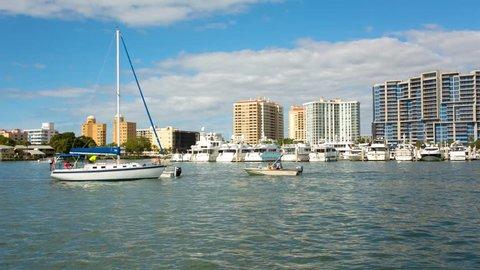 Sarasota downtown and marina view, the motor-boat floats along the gulf, Florida