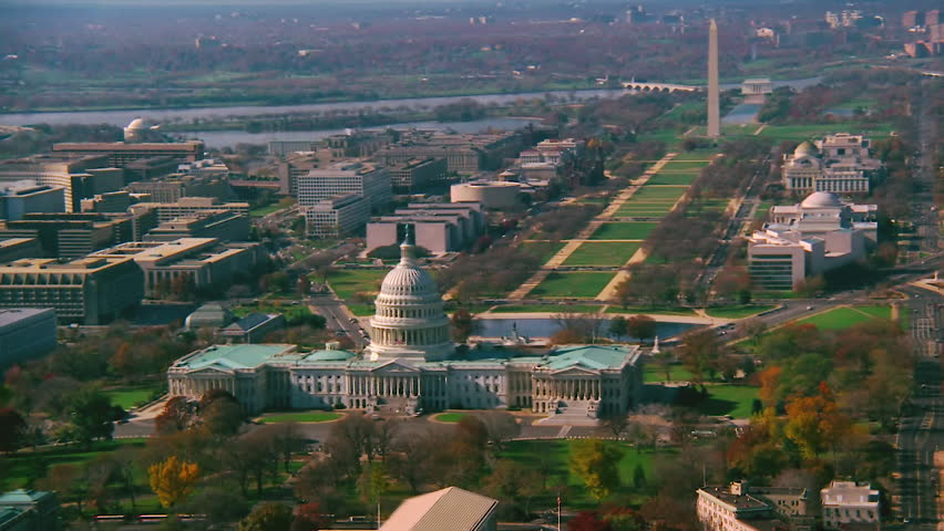 WASHINGTON DC - CIRCA 1990s - 1990s - Good aerial over capitol dome, Congress and Washington Monument in Washington D.C.