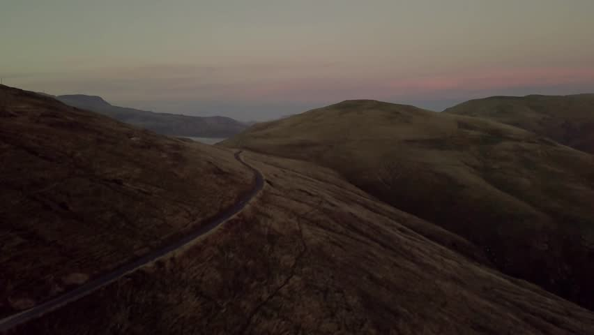 Coast of New Zealand shot by drone during sunrise or sunset in autumn season. Scenic and pristine nature | Shutterstock HD Video #1009448381