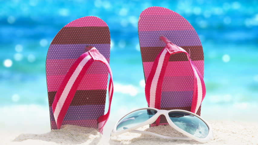 Cinemagraph: flip-flops against the sparkling tropical sea background