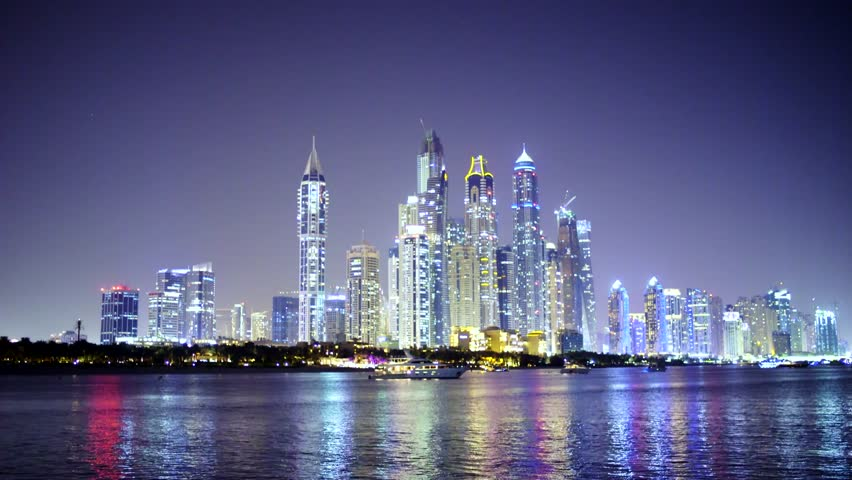 Real time Dubai City at night, panoramic scene of downtown reflected in water, yachts to the fore 4k | Shutterstock HD Video #1009517981