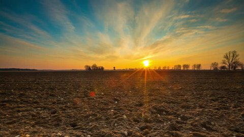 Time lapse landscape of sunset colorful sky over early spring field in Poland. 3840x2160, 24fps